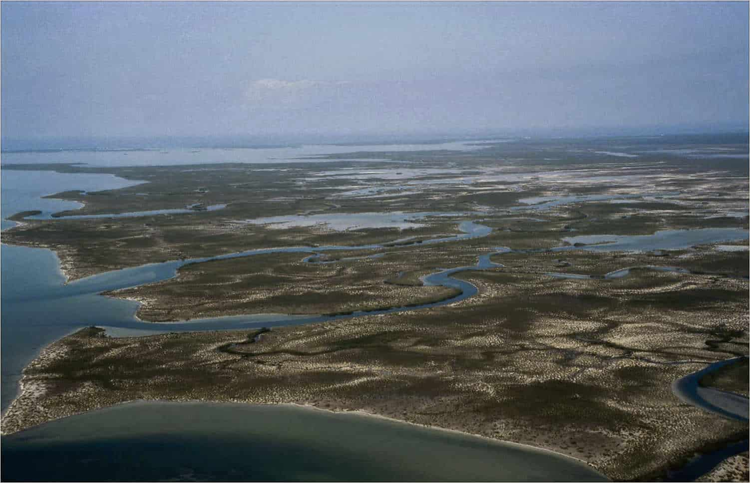 Although the Turks and Caicos Islands has extensive wetland areas, in fact it has one of the largest Ramsar Sites in the region, conditions are dry and humid, making freshwater a scarce natural resource; Copyright: Dr Mike Pienkowski
