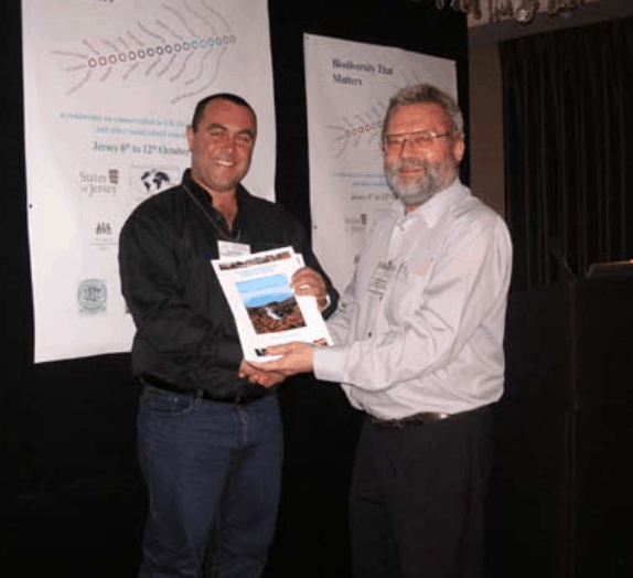 At the end of the Environmental Education session, UKOTCF Chairman, Dr Mike Pienkowski (right) presents the first copy of The Natural History of Tristan da Cunha to Simon Glass, Tristan da Cunha Conservation Officer. Funding secured by UKOTCF, for this work included a grant from the Bryan Guinness Charitable Trust