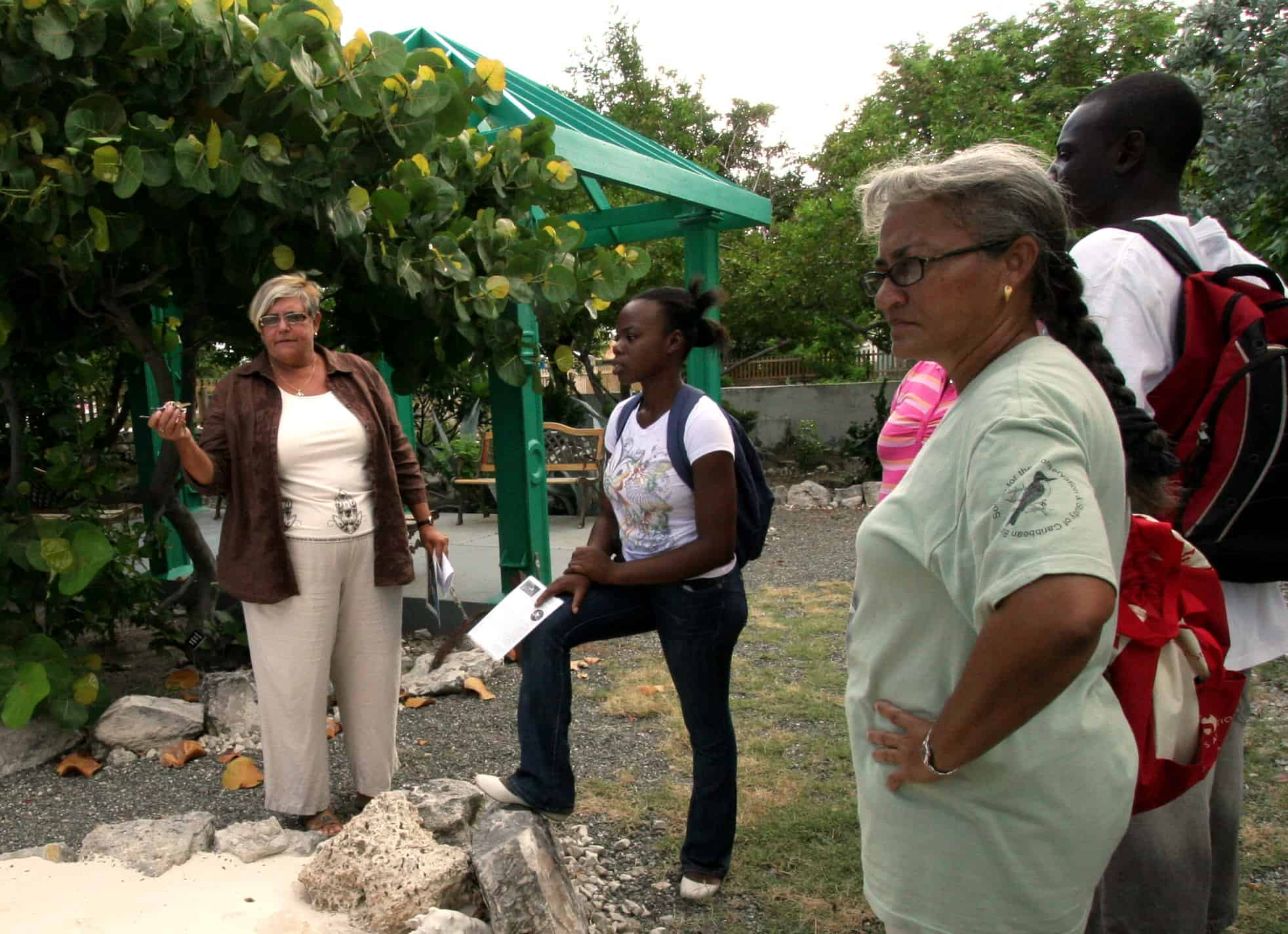 Museum Director, Pat Saxton shows a group around the TCI National Museum garden on Grand Turk; Copyright: Mike Pienkowski