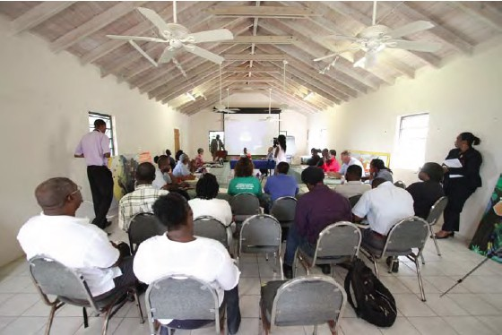 Hon. Claude Hogan opens the EIA workshop at hosted at the Montserrat National Trust offices; Copyright: UKOTCF