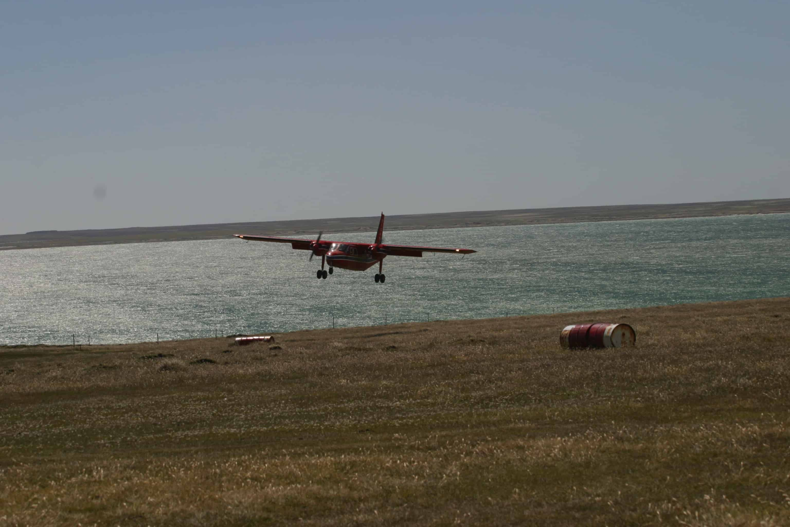 Britten-Norman Islander of Falkland Islands Government Air Service (FIGAS) lands at New Island. Copyright: Dr Mike Pienkowski