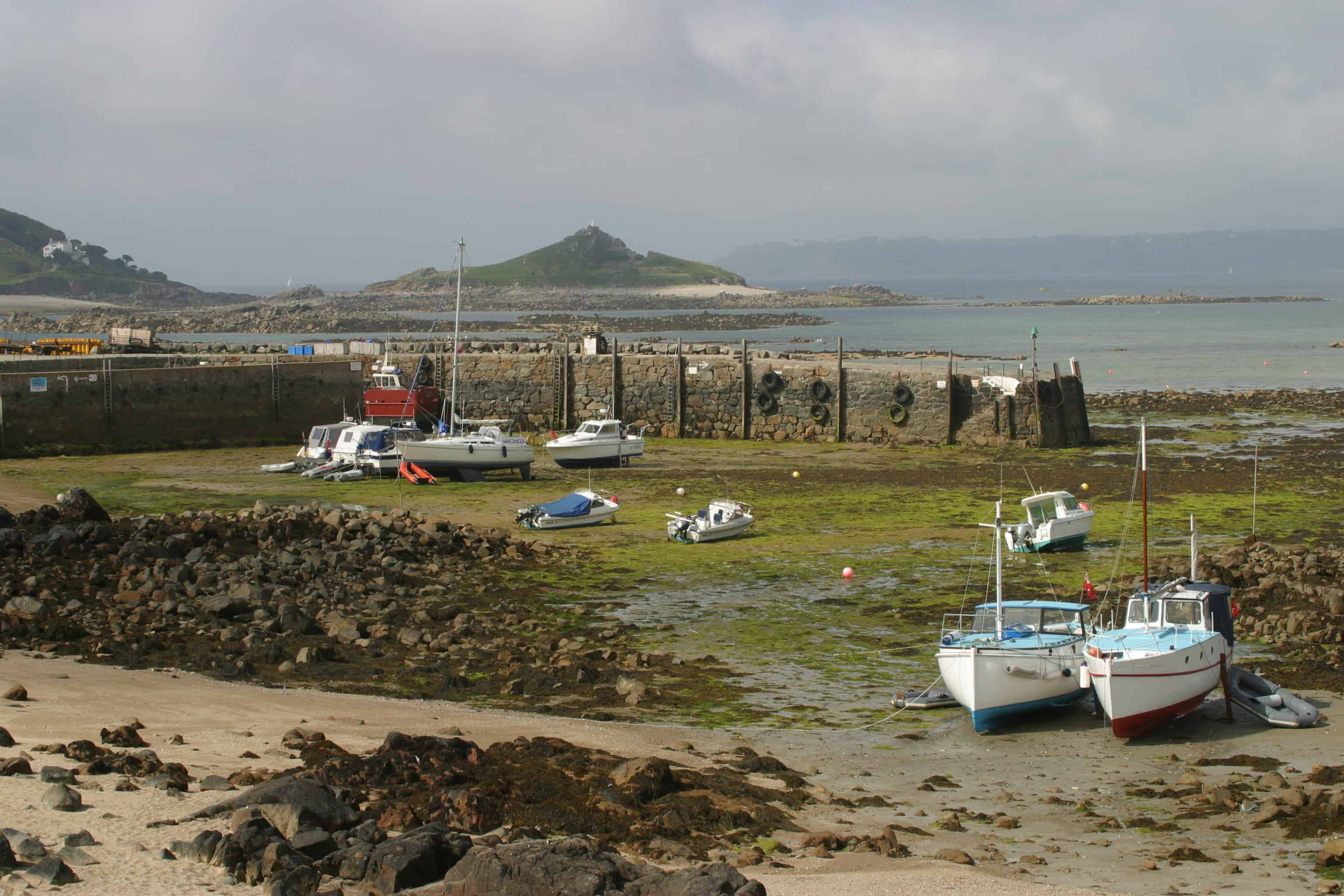 One of the harbours, with boats grounded for much of the tidal cycle, illustrates the huge tidal range of the Channel Islands. Copyright: Dr Mike Pienkowski