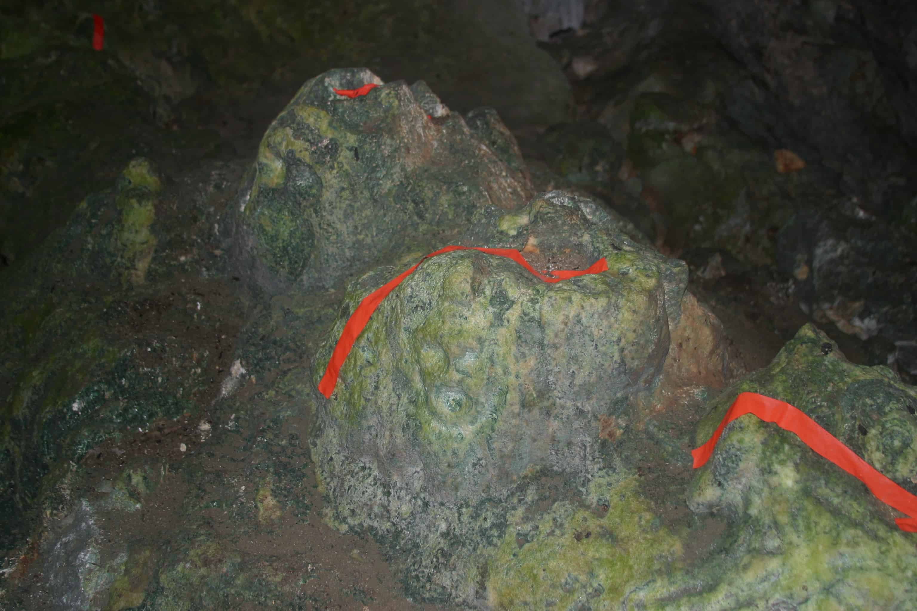 Ancient carving in Fountain Cavern (the red tape is simply to draw attention to the feature in the low light. Copyright: Dr Mike Pienkowski