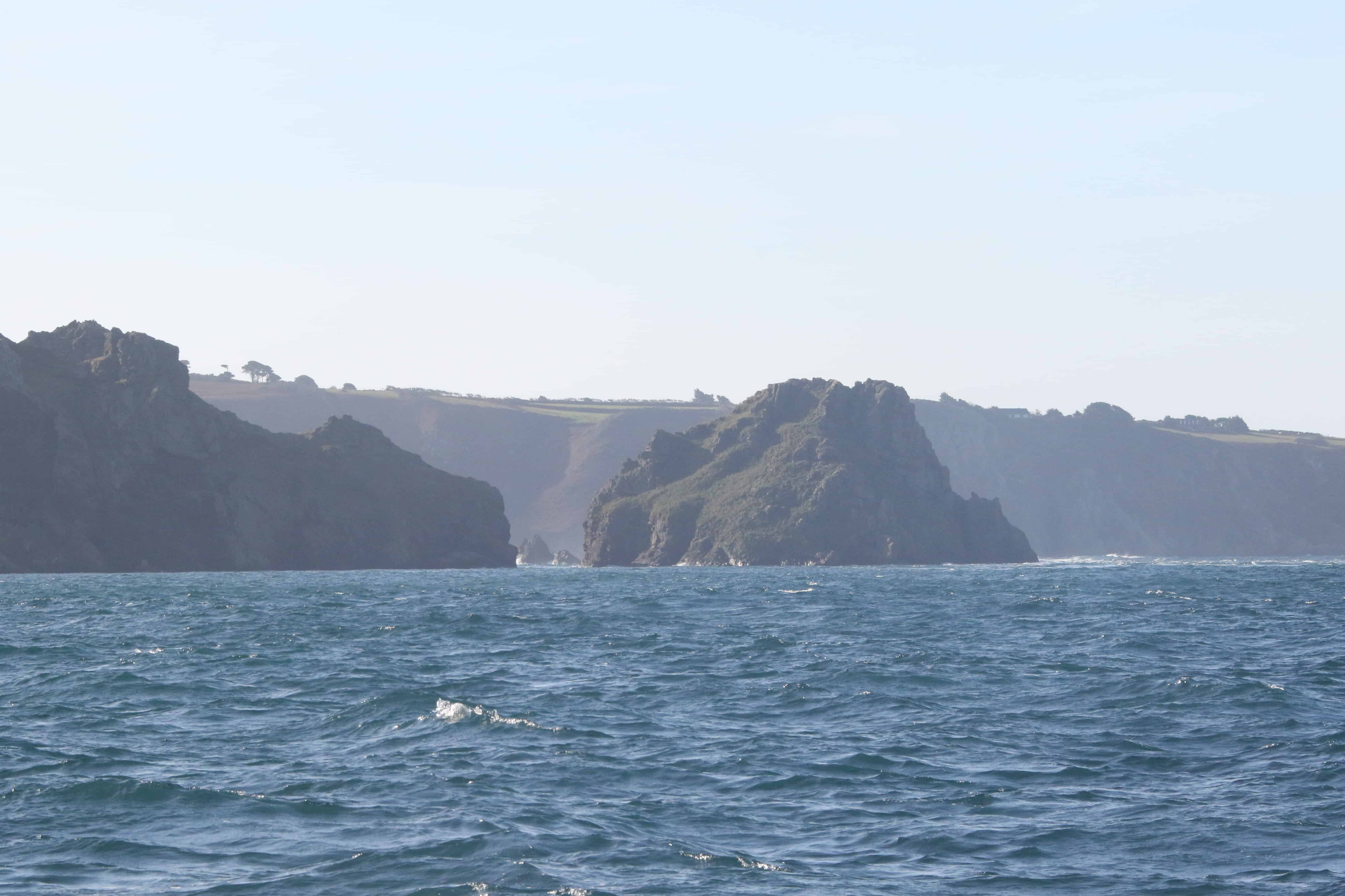 Gouliot Headland, holding the cave, on the left of the picture; Copyright: Dr Mike Pienkowski