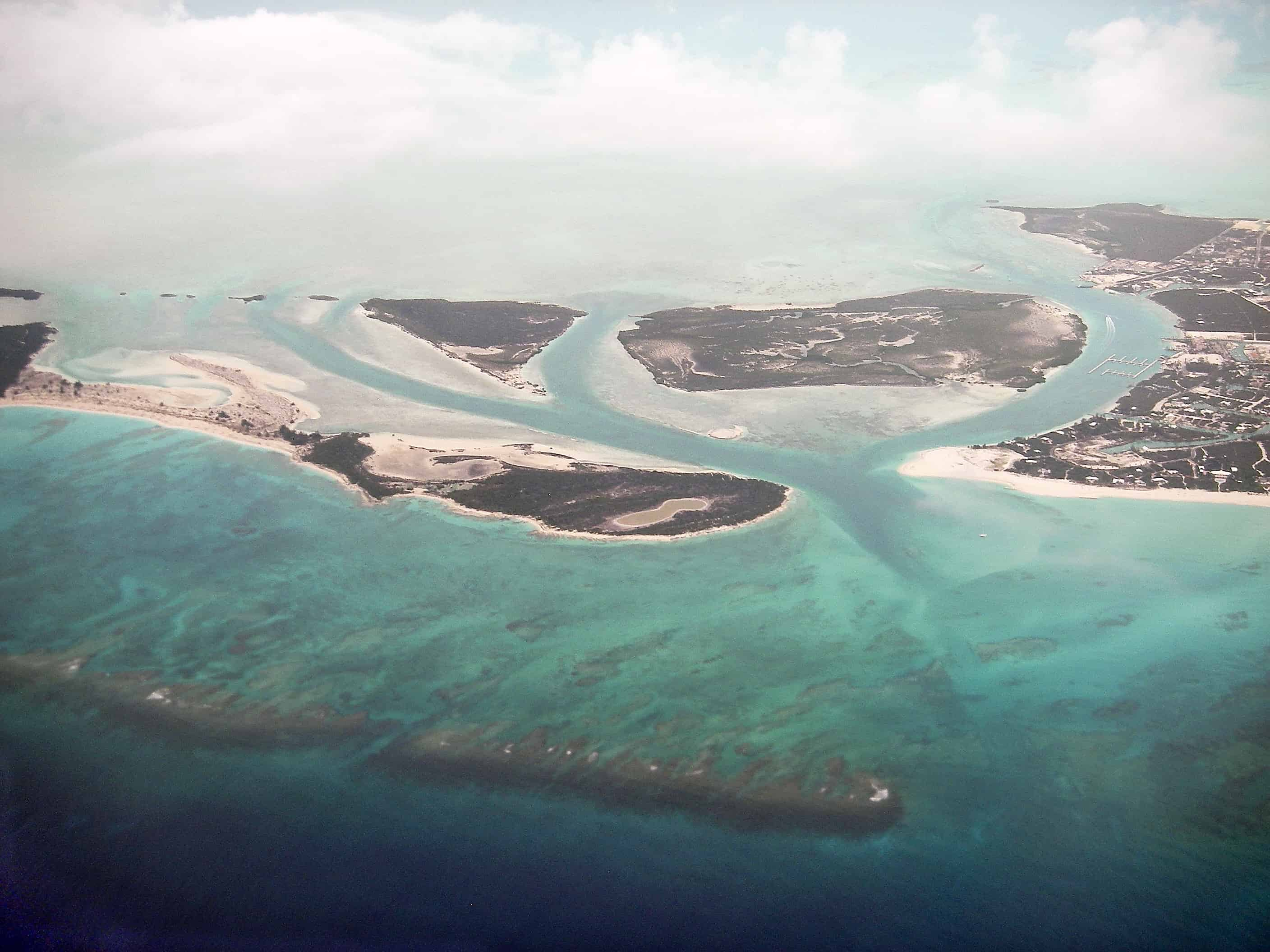Water, Little Water, Donna and Mangrove Cays, the Leeward Wideopens Channel and fringing reef off the eastern end of Providenciales (to right). Copyright: Dr Mike Pienkowski