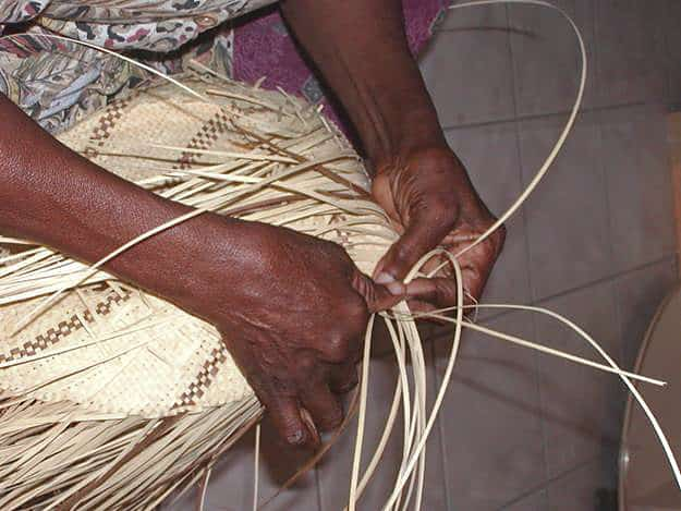 Basket making from local plant material, especially the native palms. Copyright: Dr Mike Pienkowski