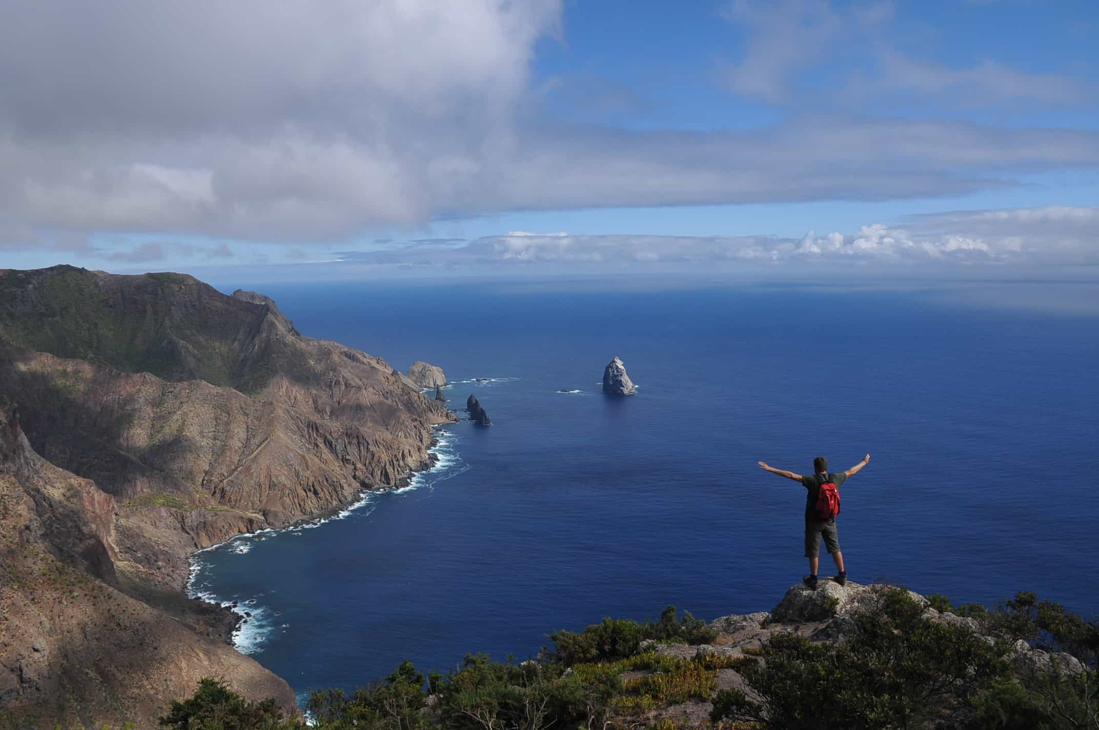 Felix takes a moment to admire view at Horsecliff on St Helena between survey work with the St Helena National Trust